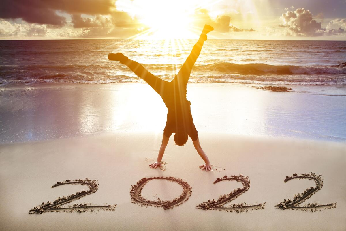 young man handstand on the beach.happy new year 2021 concept